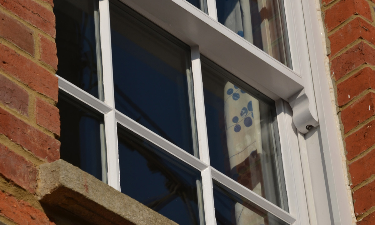White hand painted timber window frames