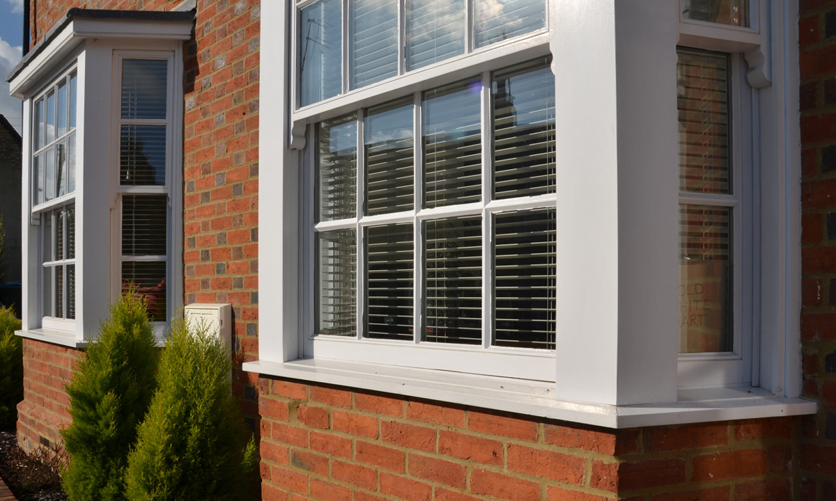 Bespoke glass window with white timber frames